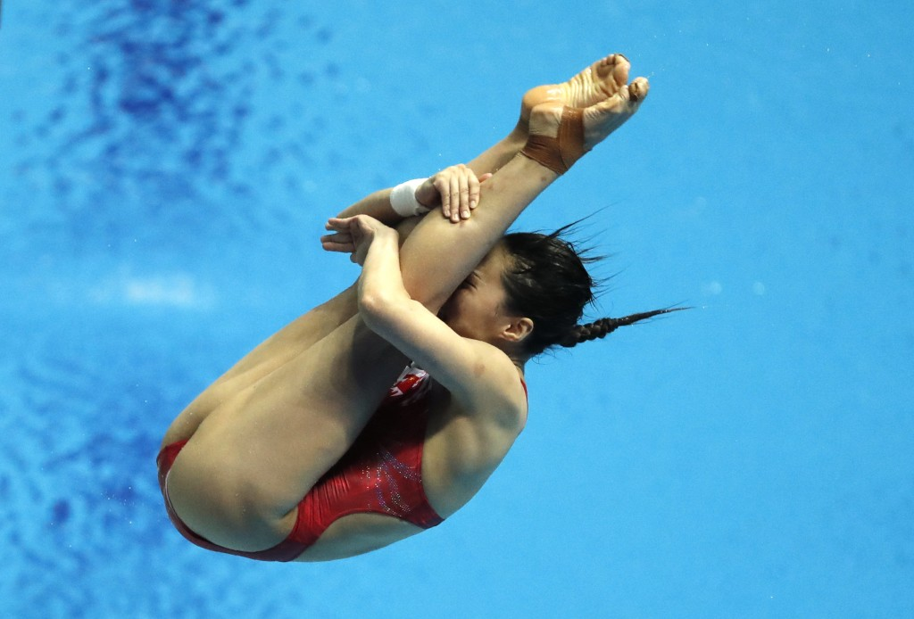 China's Wang Han competes in the women's 3m springboard divin final at the World Swimming Championships in Gwangju, South Korea, Friday, July 19, 2019...