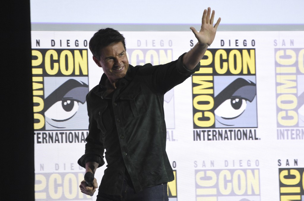 """Tom Cruise waves to the audience after presenting a clip from """"Top Gun: Maverick"""" on day one of Comic-Con International on Thursday, July 18, 2019, in..."""