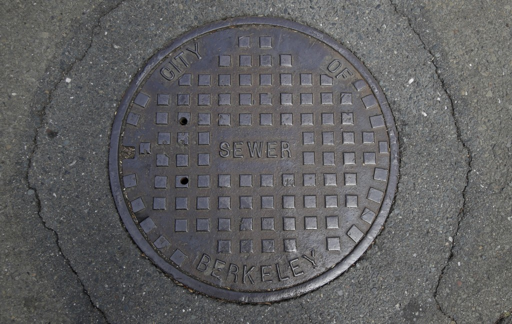 A cover for a sewer is shown in an intersection in Berkeley, Calif., Thursday, July 18, 2019. There are no manholes in Berkeley, as city workers will ...