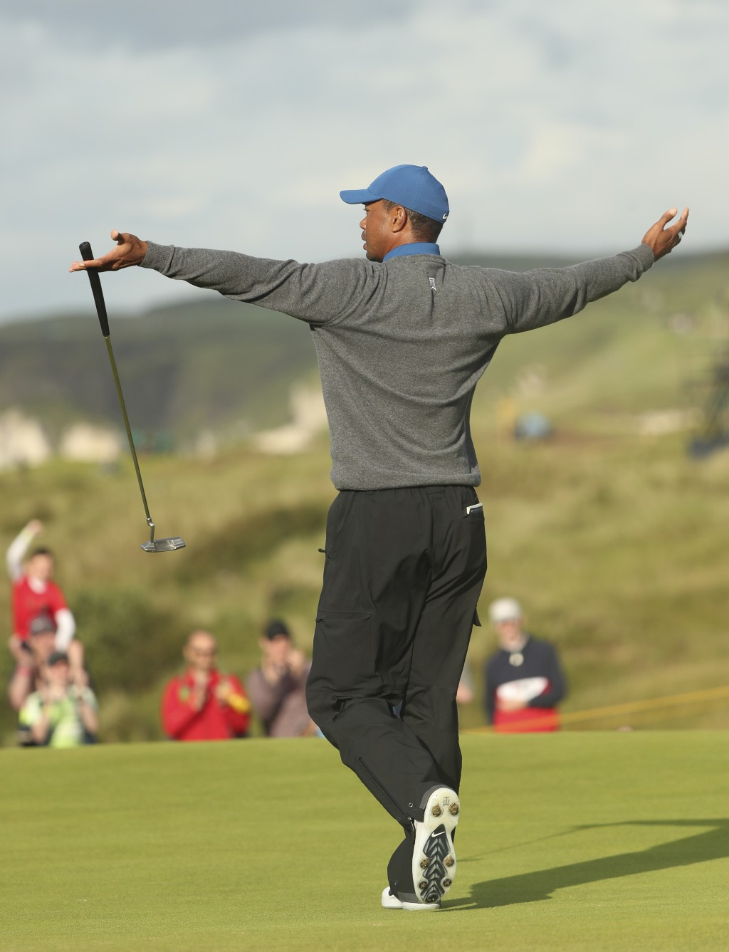 Tiger Woods of the United States celebrates after getting a birdie on the 16th green during the first round of the British Open Golf Championships at ...
