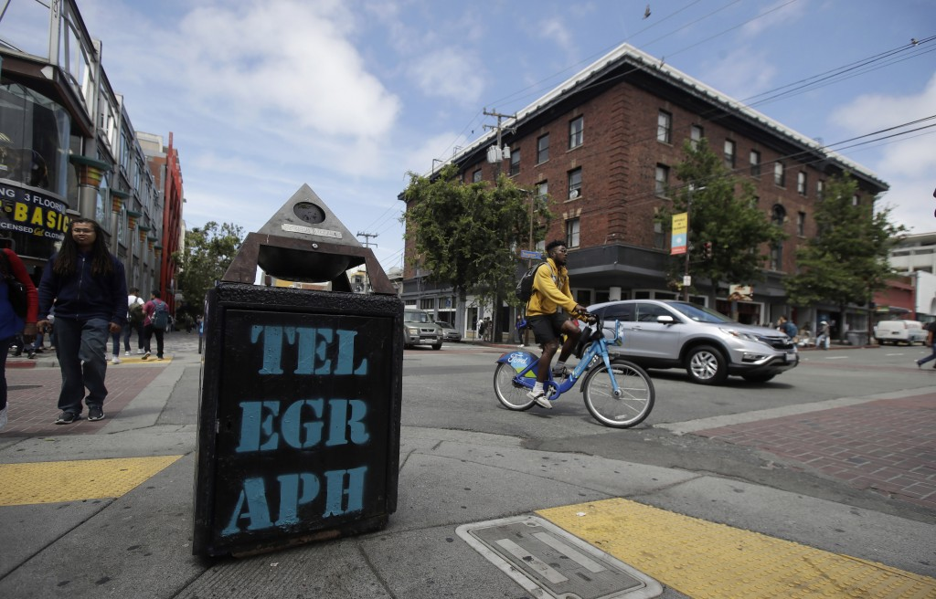 Traffic and pedestrians cross Telegraph Avenue in Berkeley, Calif., Thursday, July 18, 2019. Soon students in Berkeley, Calif., will have to pledge to...