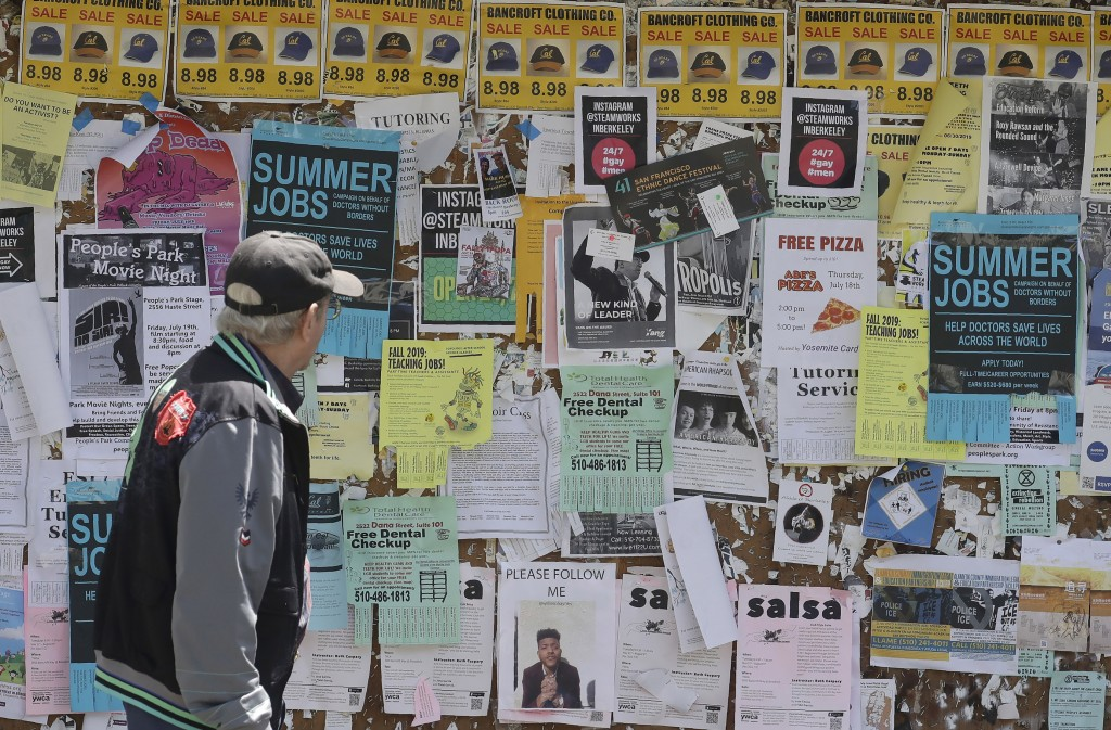 A man walks past a student activities and notices board on the University of California at Berkeley campus in Berkeley, Calif., Thursday, July 18, 201...