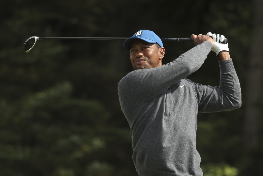 Tiger Woods of the United States plays his tee shot on the 5th hole during the first round of the British Open Golf Championships at Royal Portrush in...