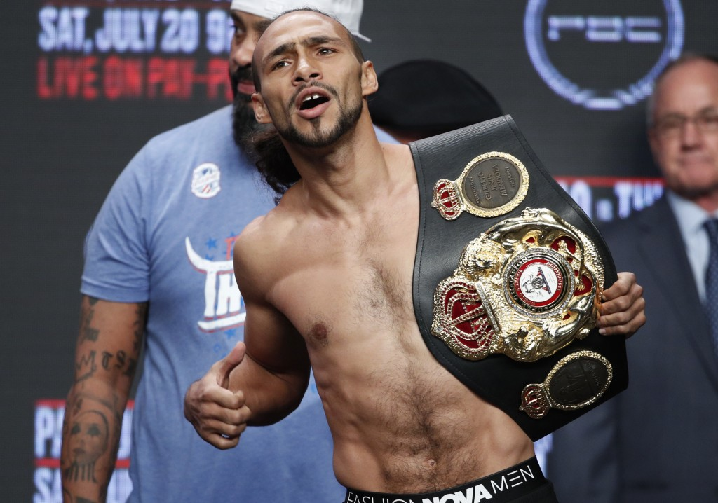 Keith Thurman holds a belt during a weigh-in Friday, July 19, 2019, in Las Vegas. Thurman is scheduled to fight Manny Pacquiao in a welterweight champ...