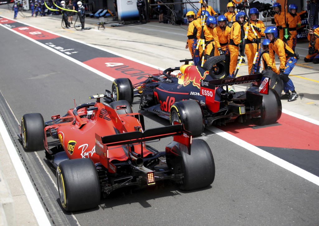 Ferrari driver Charles Leclerc of Monac, left, tries to overtake Red Bull driver Max Verstappen of the Netherland's after a pit service, during the Br...