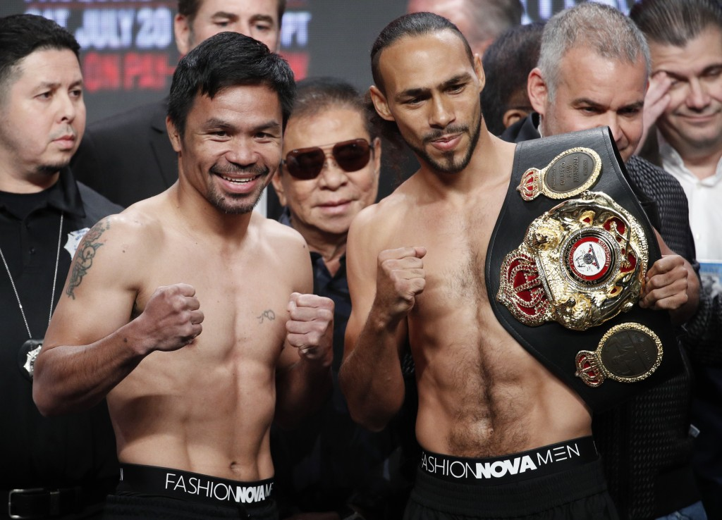 Manny Pacquiao, second from left, and Keith Thurman pose during a weigh-in Friday, July 19, 2019, in Las Vegas. The two are scheduled to fight in a we...