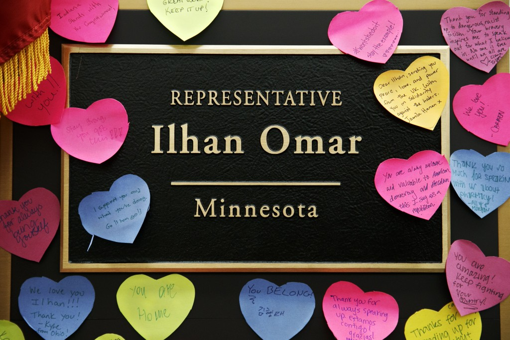 Heart shaped notes line the wall outside the office of Rep. Ilhan Omar, D-Minn., Friday, July 19, 2019, part of a day-long solidarity vigil organized ...