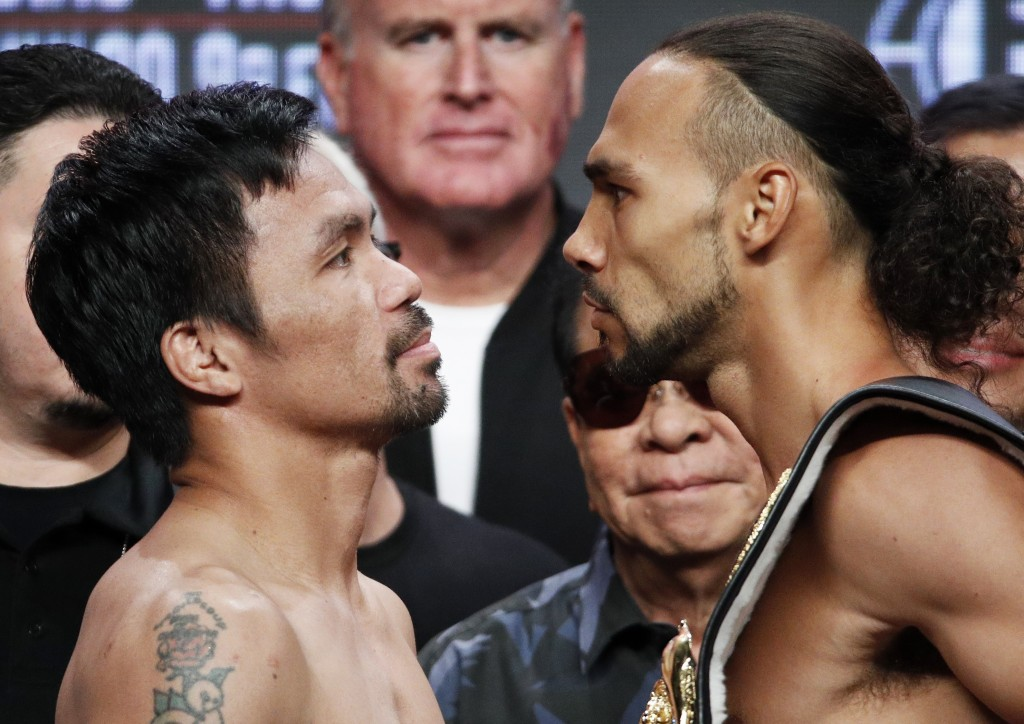 Manny Pacquiao, left, and Keith Thurman pose during a weigh-in Friday, July 19, 2019, in Las Vegas. The two are scheduled to fight in a welterweight c