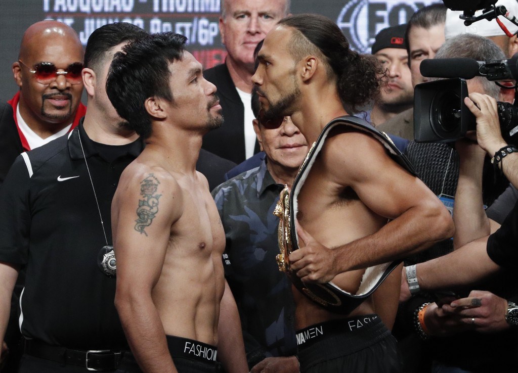 Manny Pacquiao, front left, and Keith Thurman pose during a weigh-in Friday, July 19, 2019, in Las Vegas. They are scheduled to fight in a welterweigh...