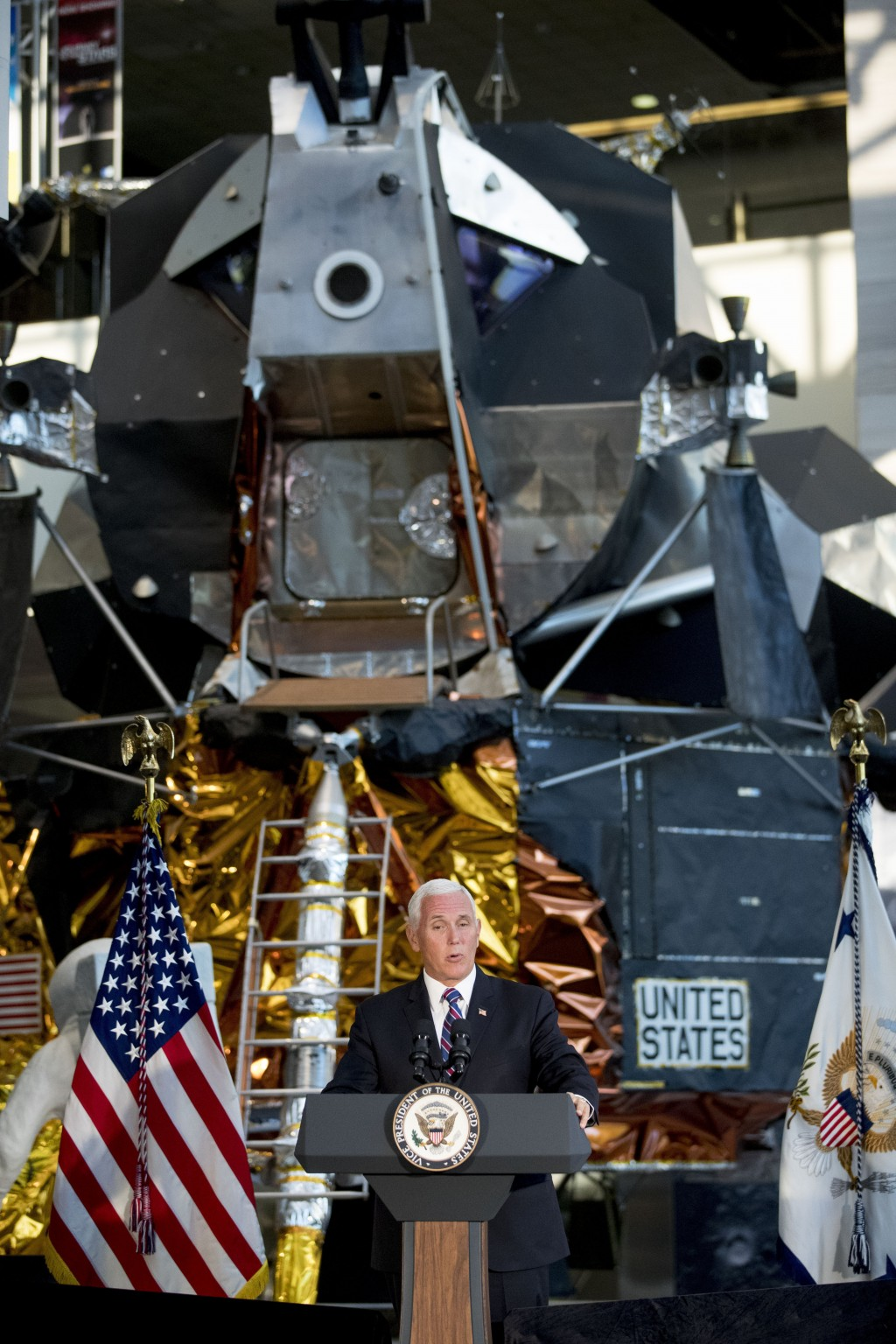 FILE - In this July 16, 2019 file photo, a lunar module, the same type that landed on the moon for Apollo 11, is displayed behind Vice President Mike ...