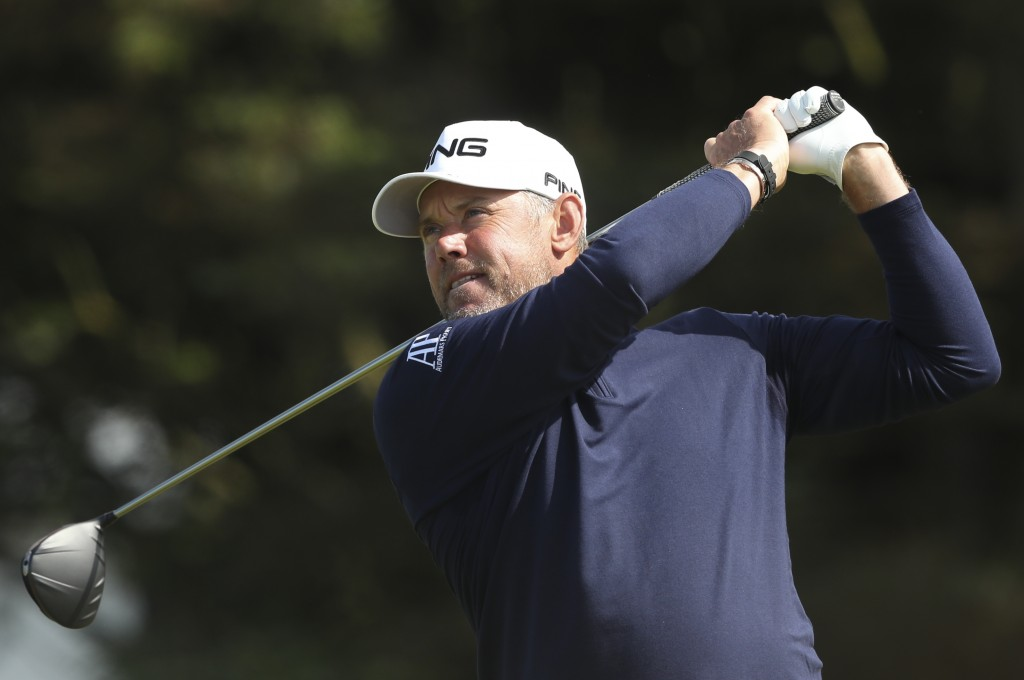 England's Lee Westwood tees off from the 5th hole during the third round of the British Open Golf Championships at Royal Portrush in Northern Ireland,...