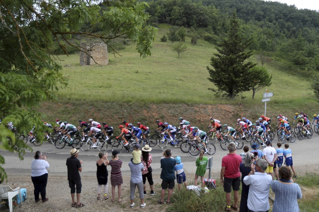 Spectators watch the riders during the fifteenth stage of the Tour de France cycling race over 185 kilometers (114,95 miles) with start in Limoux and ...