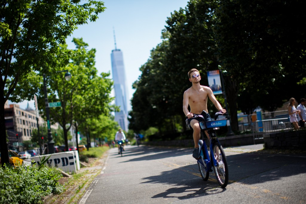 Cyclists ride down a path near the Hudson River during high temperatures on Saturday, July 20, 2019 in New York. Temperatures in the high 90s are fore...