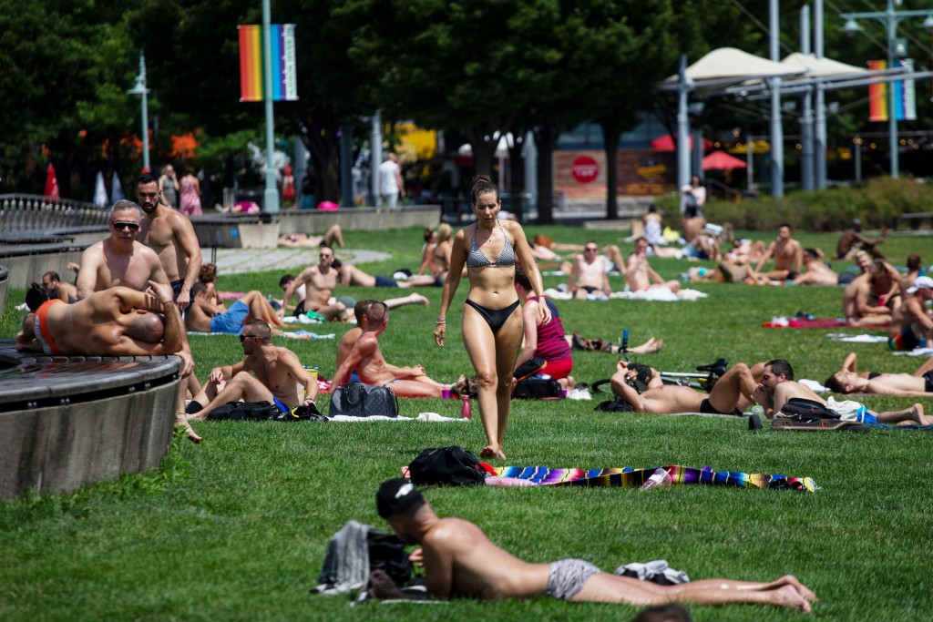 People sunbathe at Pier 45 on Saturday, July 20, 2019 in New York. Temperatures in the high 90s are forecast for Saturday and Sunday with a heat index...