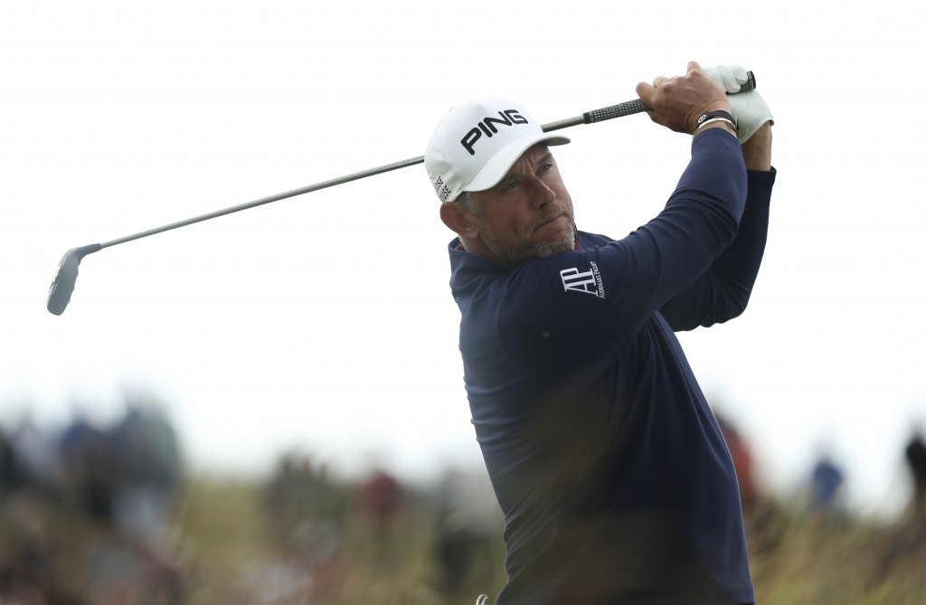 England's Lee Westwood plays his tee shot on the 8th hole during the third round of the British Open Golf Championships at Royal Portrush in Northern ...