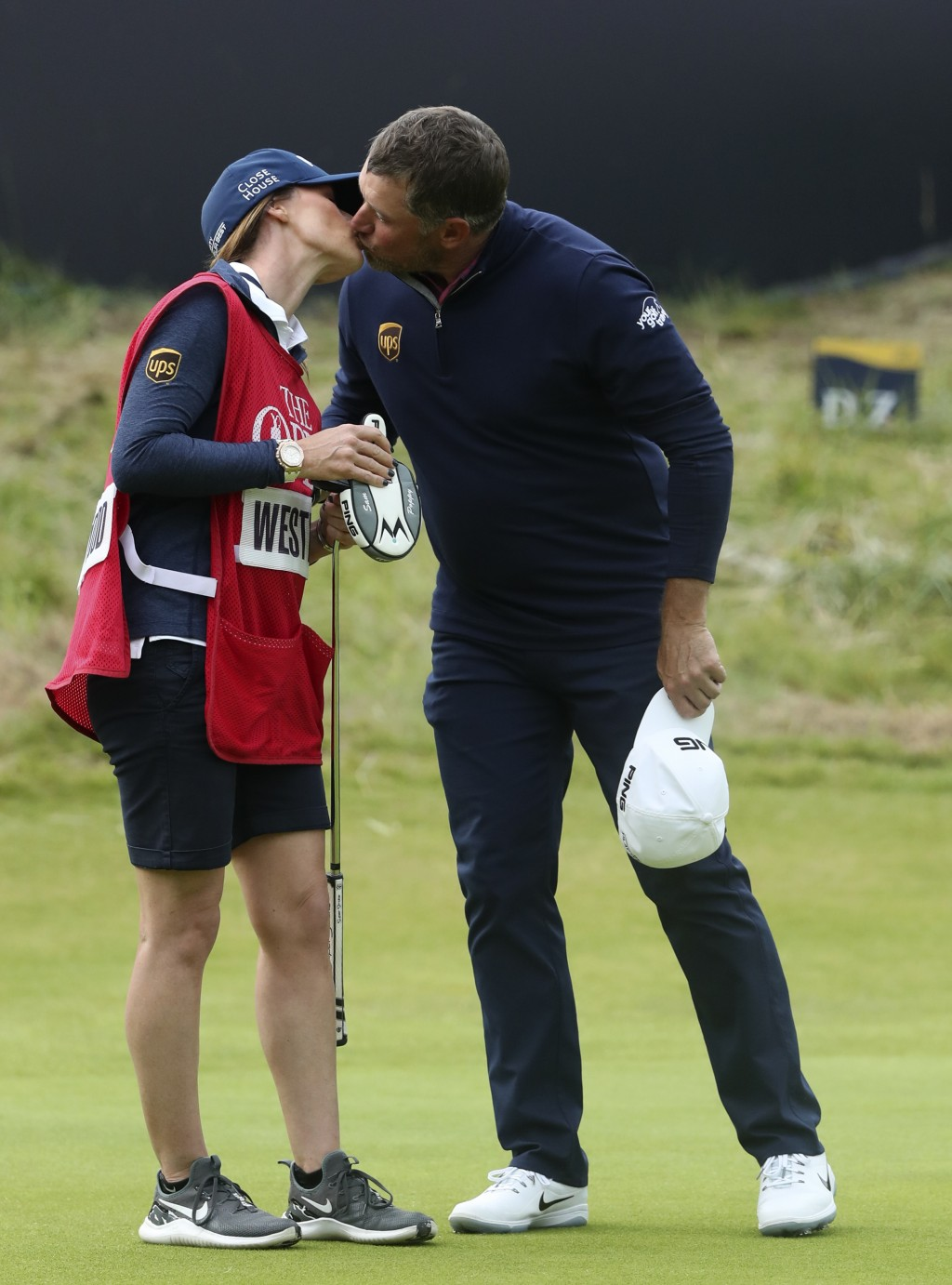 England's Lee Westwood kisses his caddie and girlfriend Helen Storey on the 18th green after completing his third round of the British Open Golf Champ...