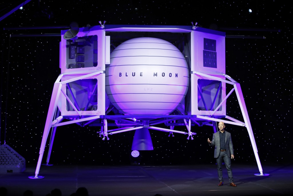 FILE - In this, May 9, 2019, file photo, Jeff Bezos speaks in front of a model of Blue Origin's Blue Moon lunar lander in Washington. Bezos and Virgin...