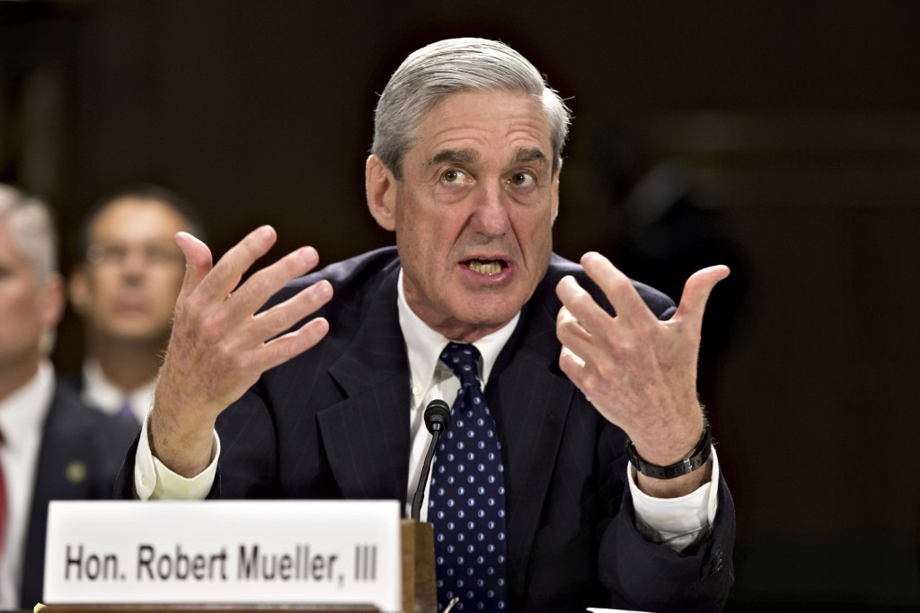 FILE - In this June 19, 2013, file photo, then-FBI Director Robert Mueller testifies on Capitol Hill in Washington. When special counsel Mueller testi...