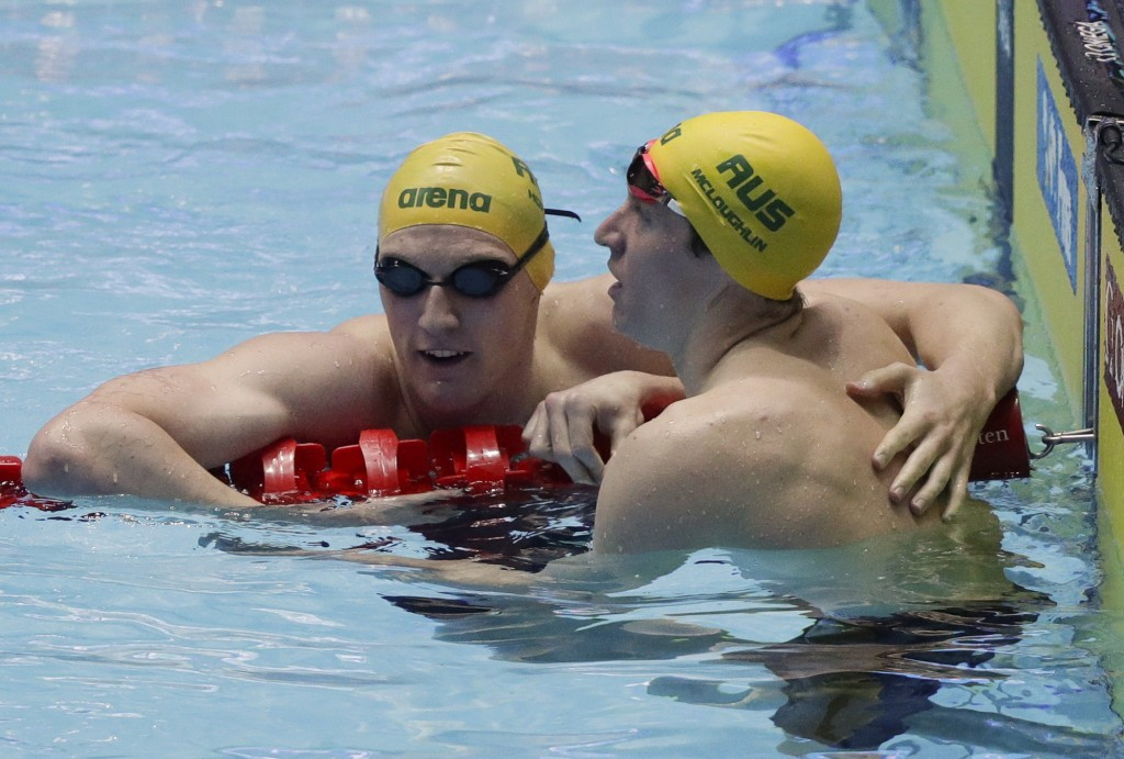 Australia's Mack Horton, left, is congratulated by teammate Jack McLoughlin after his second place finish in the men's 400m freestyle final at the Wor...