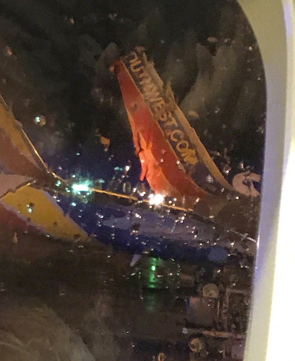This photo taken onboard by a passenger on a Southwest Airlines flight to Atlanta appears to show the top fin of another Southwest Airlines plane clip...