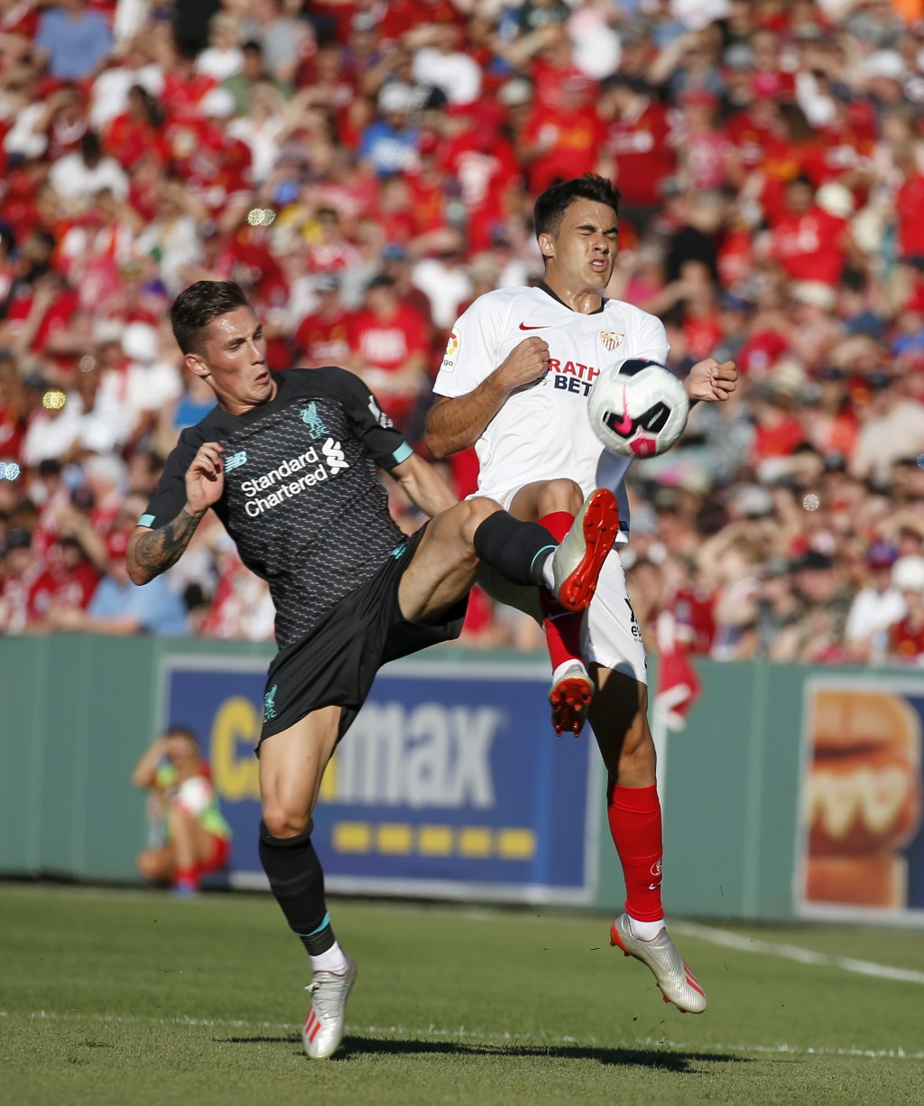 Liverpool's Harry Wilson, left, and Sevilla's Reguilon Rodriguez Sergio vie for the ball during the first half of a friendly soccer match at Fenway Pa...