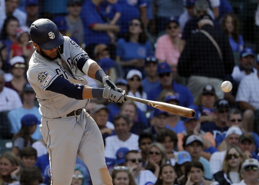 San Diego Padres' Fernando Tatis Jr. hits a two-run single during the ninth inning of a baseball game against the Chicago Cubs in Chicago, Sunday, Jul...