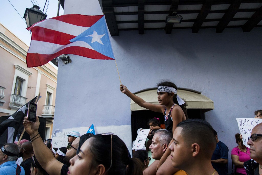 Demonstrators protest against Gov. Ricardo Rossello in San Juan, Puerto Rico, Sunday, July 21, 2019. Puerto Rico's embattled governor says he will not...