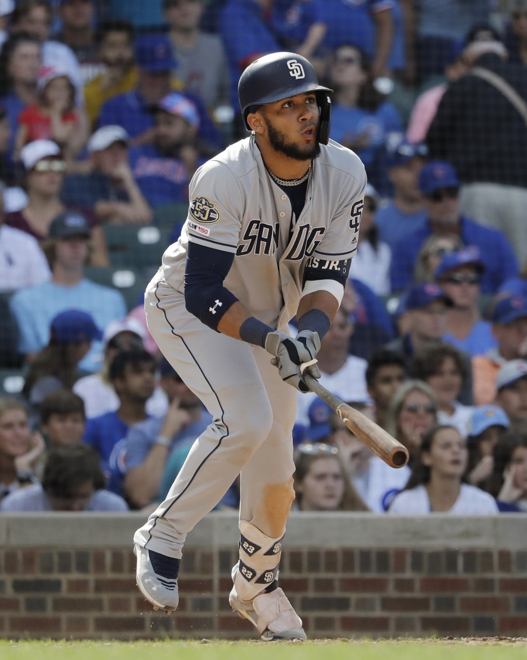 San Diego Padres' Fernando Tatis Jr., watches his two-run single during the ninth inning of a baseball game against the Chicago Cubs in Chicago, Sunda...