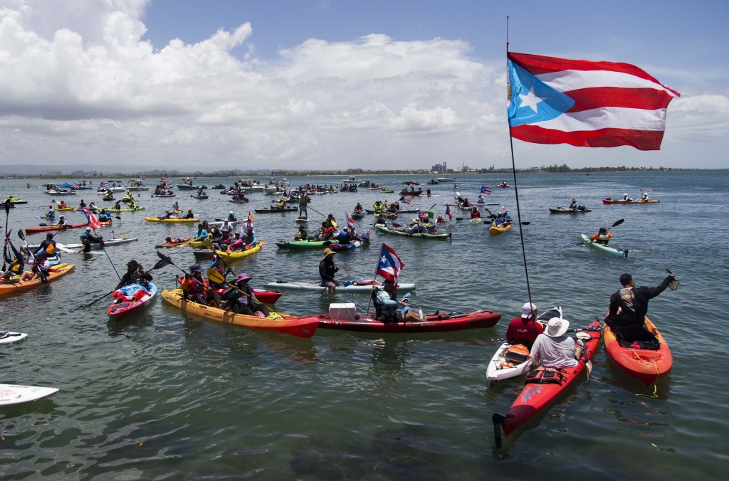 Demonstrators in kayaks gathered in front of La Fortaleza for an aquatic protest against Puerto Rico Gov. Ricardo Rossello in San Juan, Puerto Rico, S...