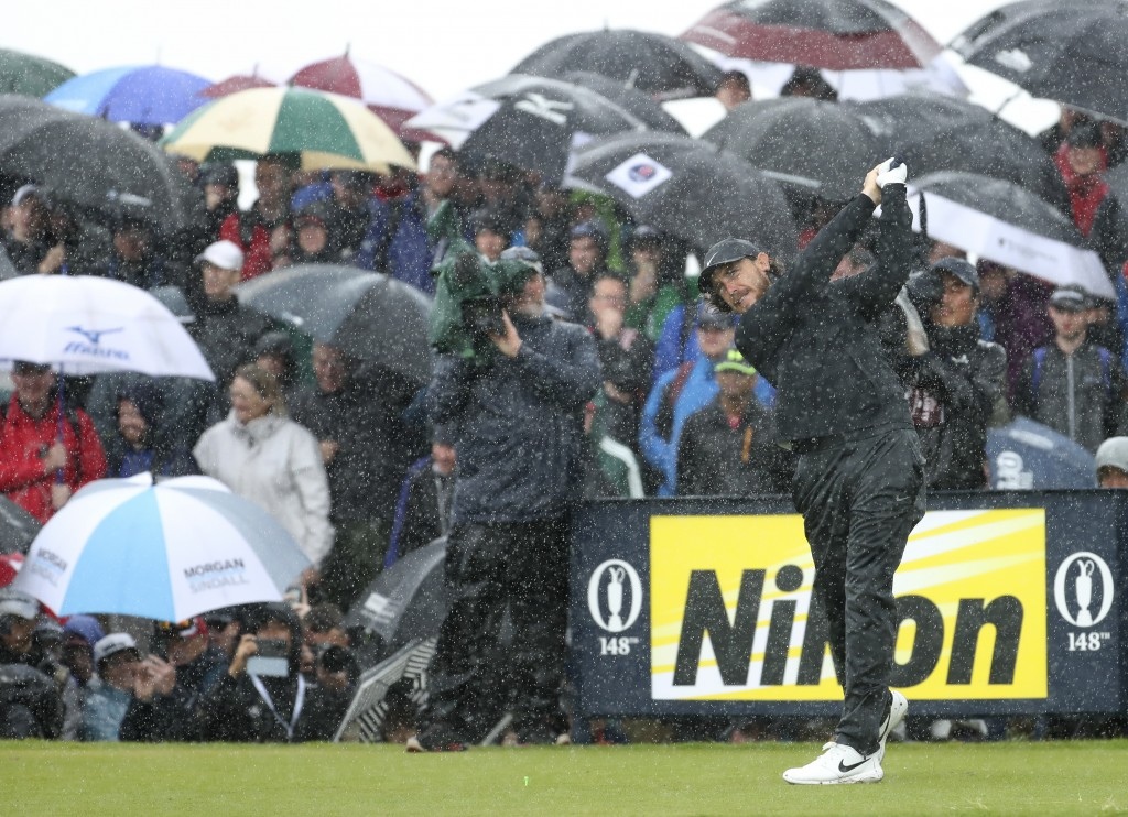 England's Tommy Fleetwood tees off the 9th tee hole in heavy rain during the final round of the British Open Golf Championships at Royal Portrush in N...