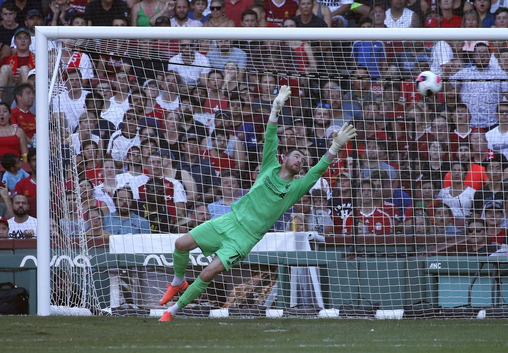 Liverpool goalie Andy Longergan is unable to make the save on a goal by Sevilla's Aguido Duran Manuel during the first half of a friendly soccer game ...