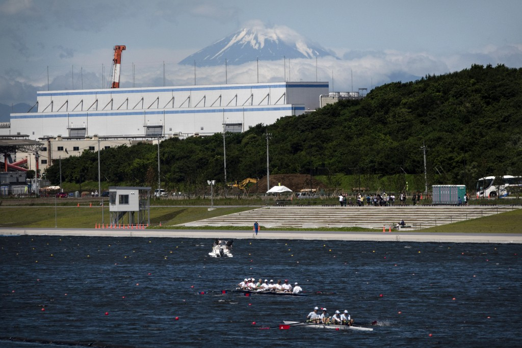 FILE - In this June 16, 2019, file photo, rowers prepare for a test run at the Sea Forest Waterway, a venue for rowing at the Tokyo 2020 Olympics, as ...