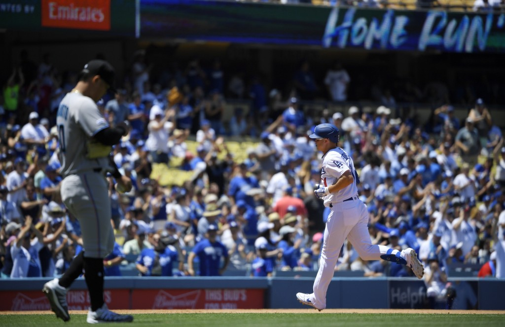 Los Angeles Dodgers' Joc Pederson, right, rounds third after hitting a two-run home run as Miami Marlins starting pitcher Jordan Yamamoto steps off th