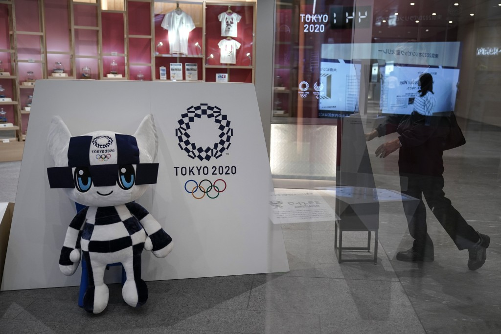 FILE - In this June 11, 2019, file photo, Miraitowa, a mascot for the Tokyo 2020 Summer Olympics, is displayed at an Olympic Corner in Tokyo. Scandals...