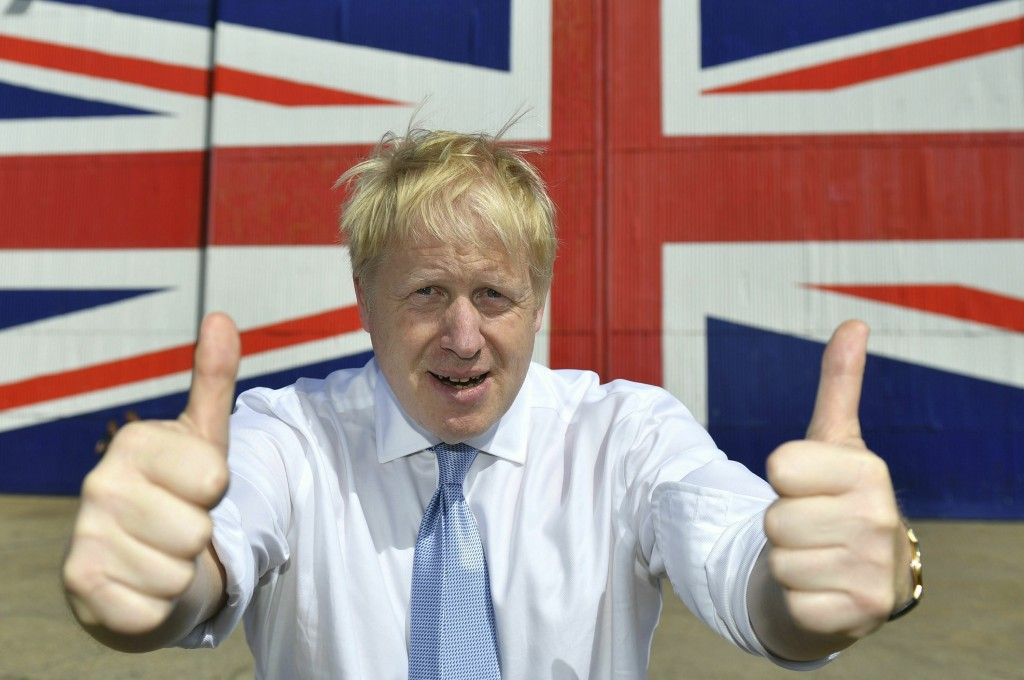 FILE - In this Thursday, June 27, 2019 file photo Conservative leadership candidate Boris Johnson gives the thumbs at the Wight Shipyard Company at Ve...