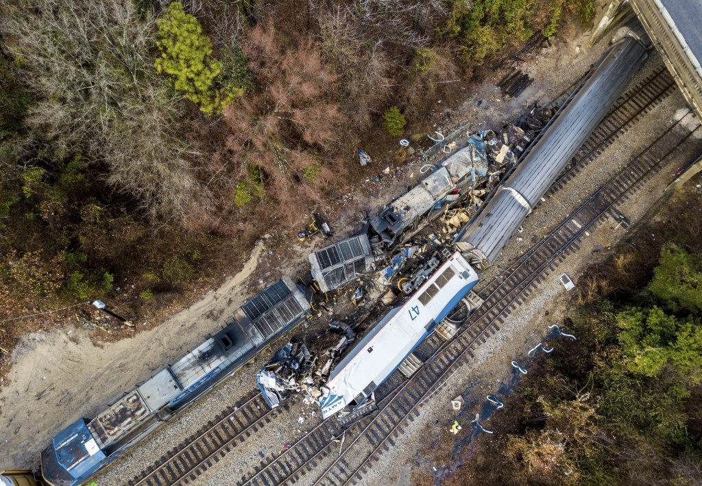 FILE- This Feb. 4, 2018, file photo shows an aerial view of the site of a fatal train crash between an Amtrak train, bottom right, and a CSX freight t...