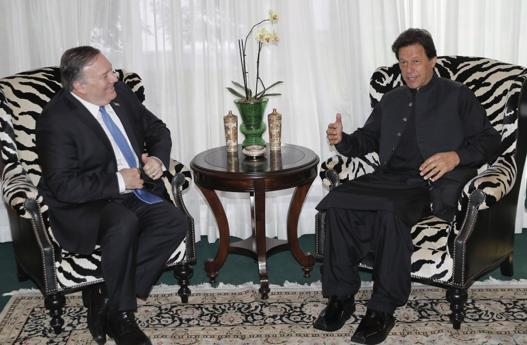Secretary of State Mike Pompeo, left, meets with Pakistani Prime Minister Imran Khan, right, at the Residence of the Pakistani Ambassador in Washingto...