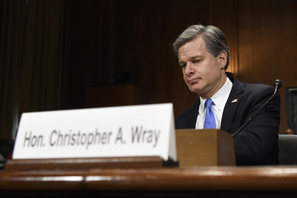 FBI Director Christopher Wray sits down to testify before the Senate Judiciary Committee on Capitol Hill in Washington, Tuesday, July 23, 2019. Wray's...
