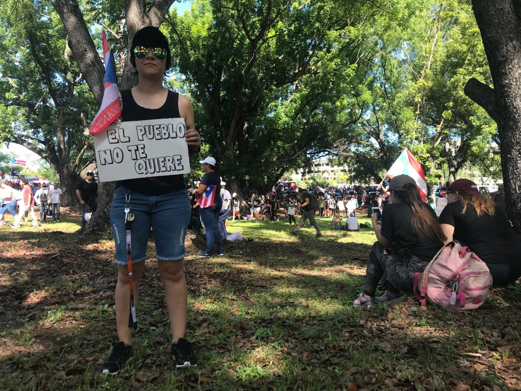 Ada Torres, who is 27 and unemployed, poses for a photo during a protest to demand the resignation of Governor Ricardo Rossello, in San Juan, Puerto R...