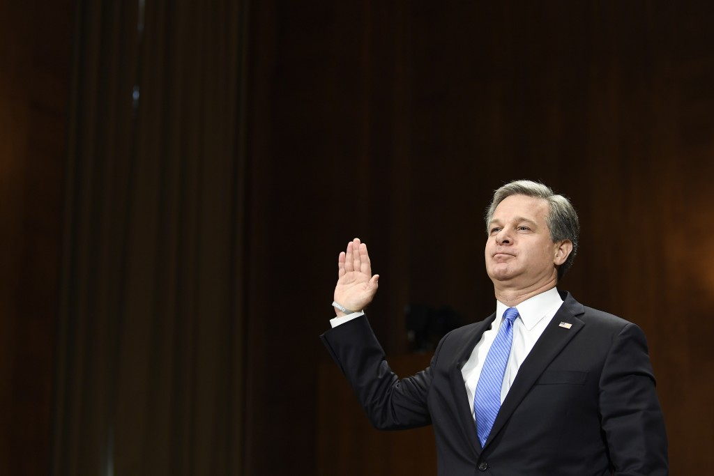 FBI Director Christopher Wray is sworn in before he testifies before the Senate Judiciary Committee on Capitol Hill in Washington, Tuesday, July 23, 2