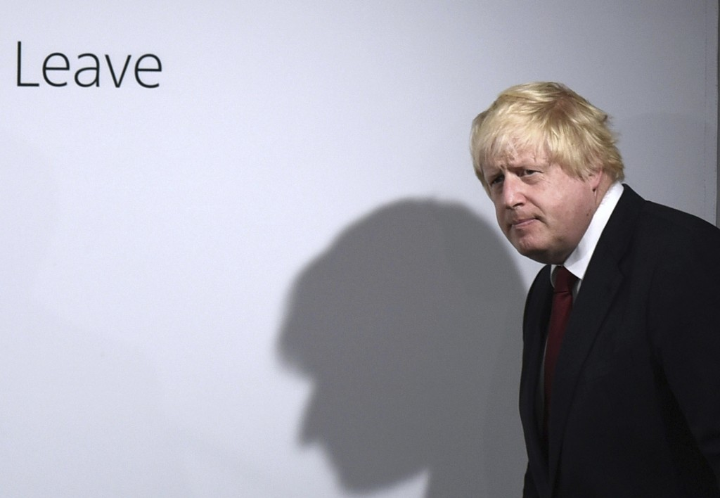 FILE - In this Friday, June 24, 2016 file photo, Vote Leave campaigner Boris Johnson arrives for a press conference at Vote Leave headquarters in Lond...