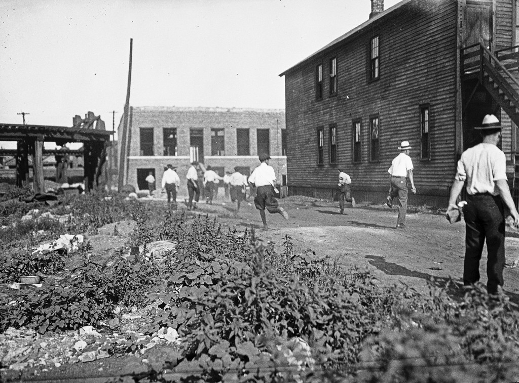 In this 1919 photo provided by the Chicago History Museum, a mob runs with bricks during the race riots in Chicago. Red Summer, as the summer of 1919 ...