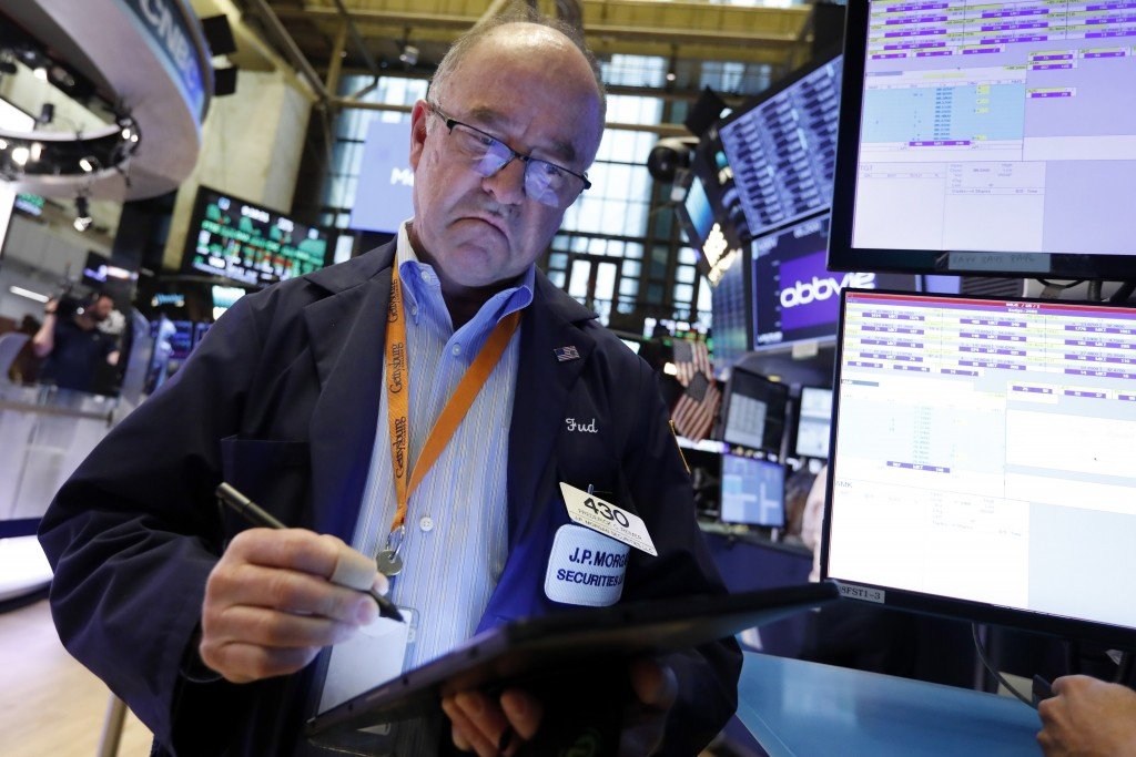 FILE - In this Friday, July 19 2019, file photo Trader Fred Reimer works on the floor of the New York Stock Exchange. The U.S. stock market opens at 9...