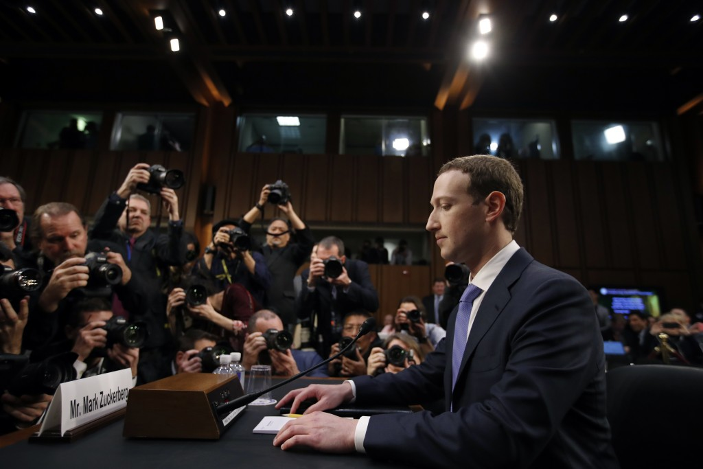 FILE - In this April 10, 2018, file photo Facebook CEO Mark Zuckerberg takes his seat to testify before a joint hearing of the Commerce and Judiciary ...