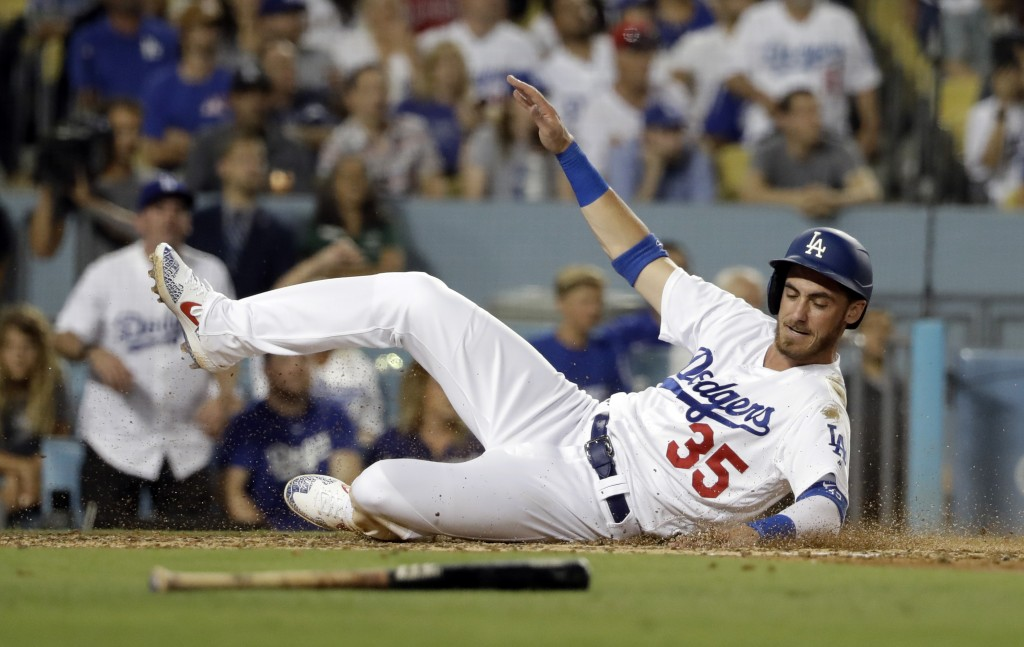 Los Angeles Dodgers' Cody Bellinger scores on a sacrifice fly from Corey Seager during the fourth inning of a baseball game against the Los Angeles An