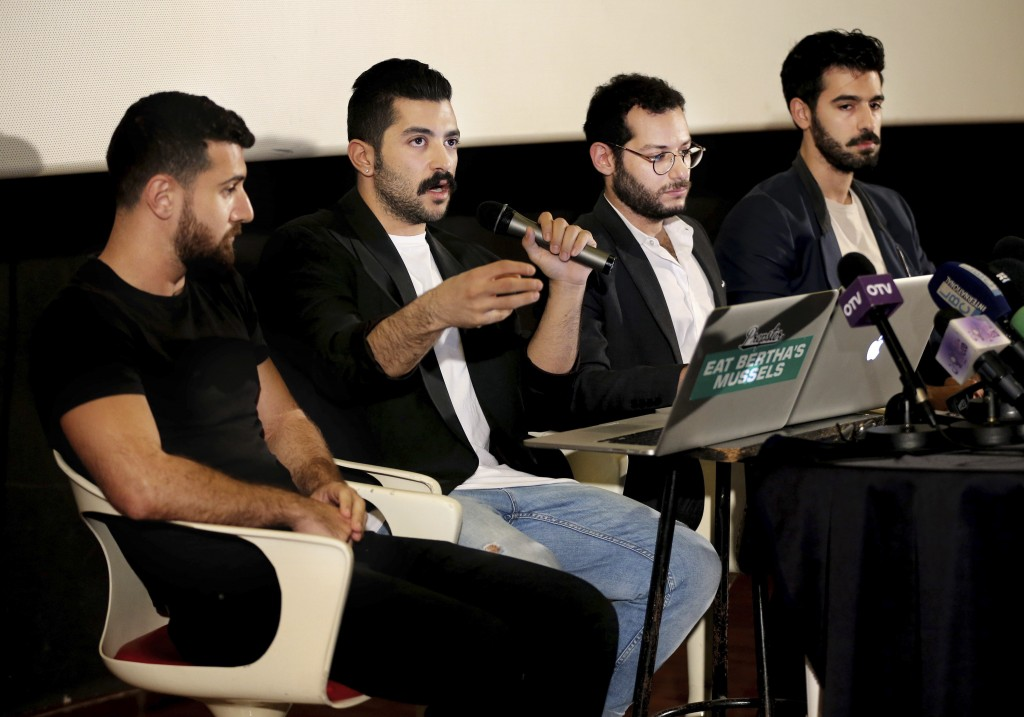 FILE - In this Thursday, April 28, 2016 file photo, Lebanese Hamed Sinno, second left, lead singer and song writer of the Lebanese group Mashrou' Leil