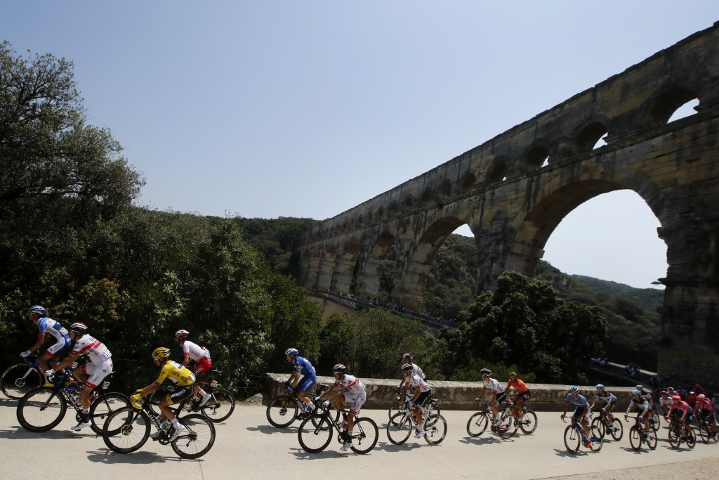 The pack rides next to the Pont du Gard during the sixteenth stage of the Tour de France cycling race over 117 kilometers (73 miles) with start and fi...