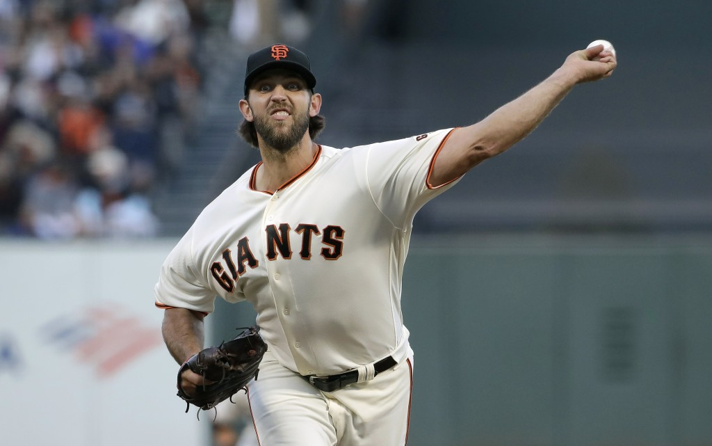 San Francisco Giants pitcher Madison Bumgarner throws to a Chicago Cubs batter during the fourth inning of a baseball game in San Francisco, Tuesday, ...