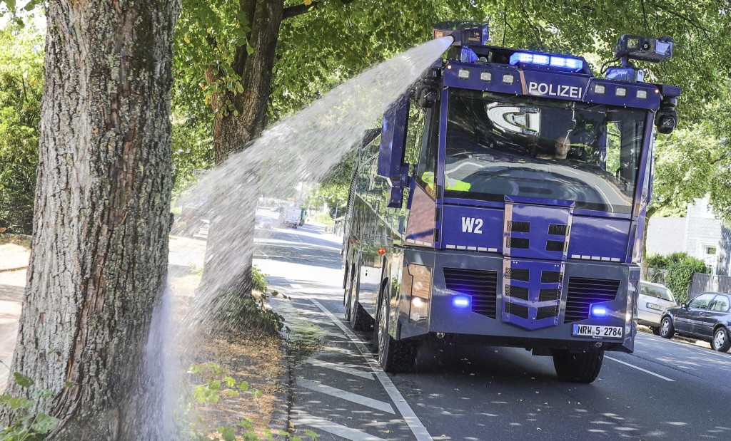 A water canon of the German police waters trees in Wuppertal, western Germany, Wednesday, July 24, 2019. Hot temperatures are expected all over Europe...