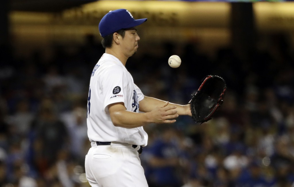 Los Angeles Dodgers starting pitcher Kenta Maeda reacts after giving up a solo home run to Los Angeles Angels' Mike Trout during the fifth inning of a